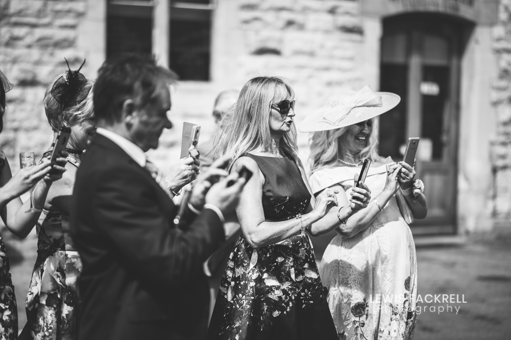 un-plugged-wedding-guests-taking-photos-iphones