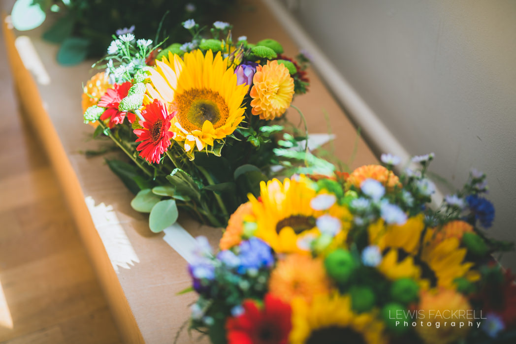 Flowers lined up for bridesmaids