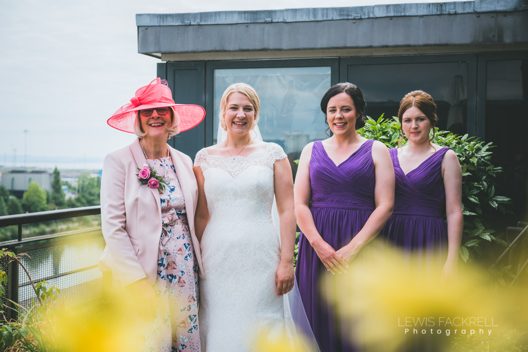 bridemaids and mother of the bride with bride in garden