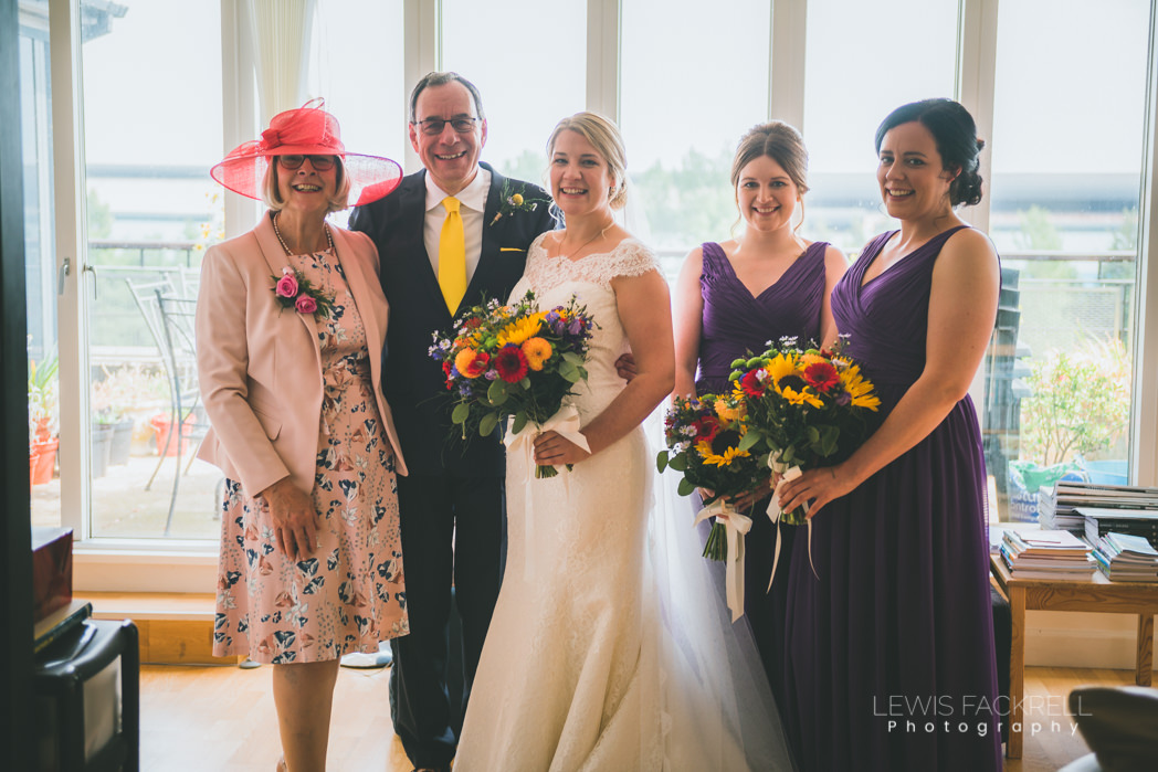 Bride and wedding party ahead of ceremony