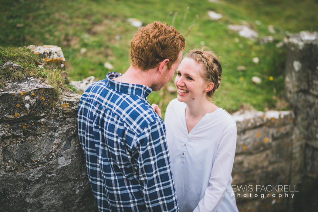 pre-wedding photoshoot Ogmore wedding couple hold eachother in southern down ruins