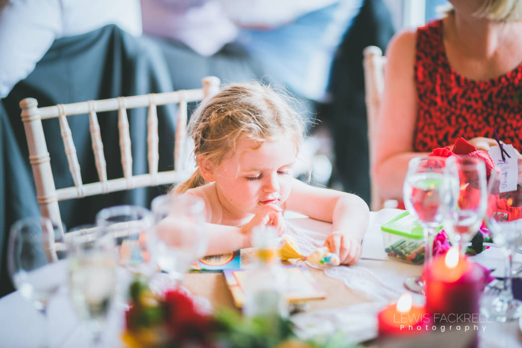 Flower girl playing on table