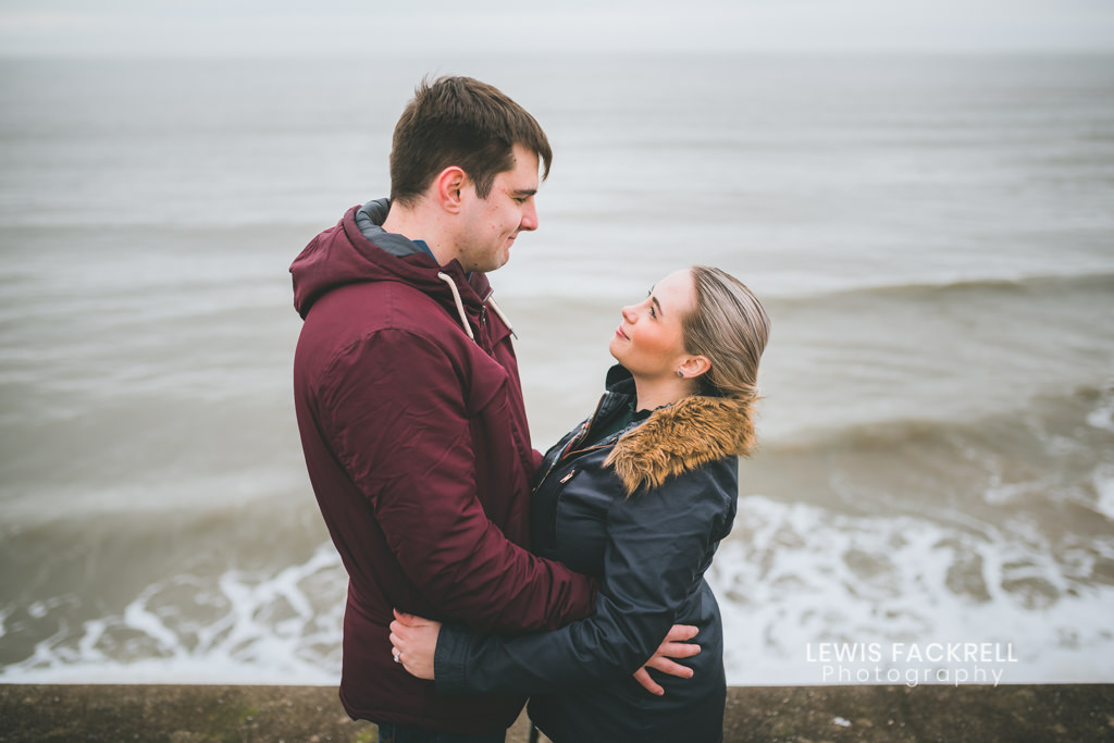 engagement photo session in porthcawl with the couple cuddling