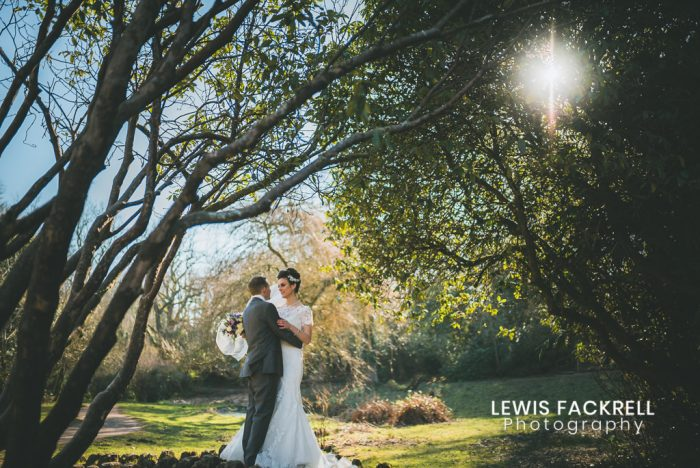 Bryngarw Wedding venues in south wales of married couple cuddling