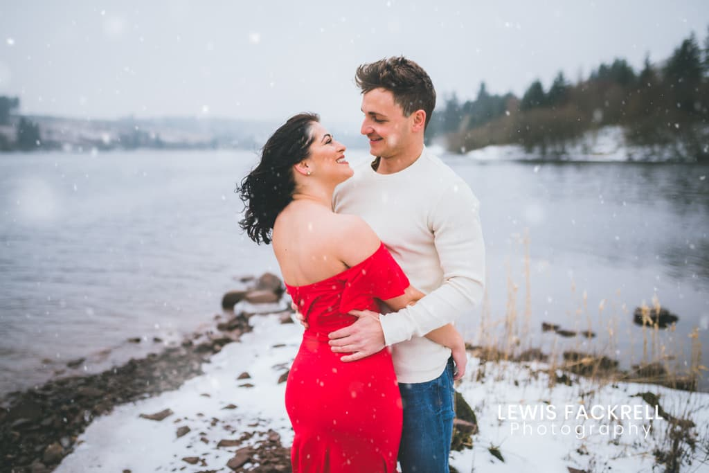 Brecon Pre-wedding photo shoot with couple in the snow by lake