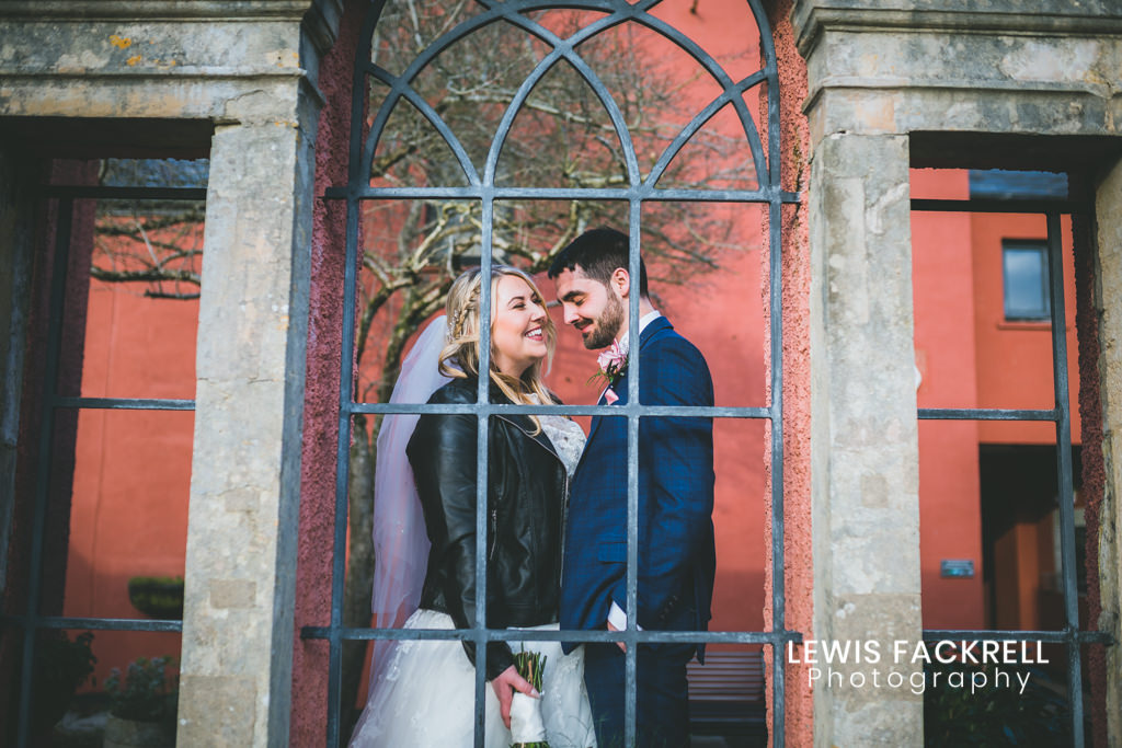 The Bear Hotel Wedding portraits of bride and groom in window