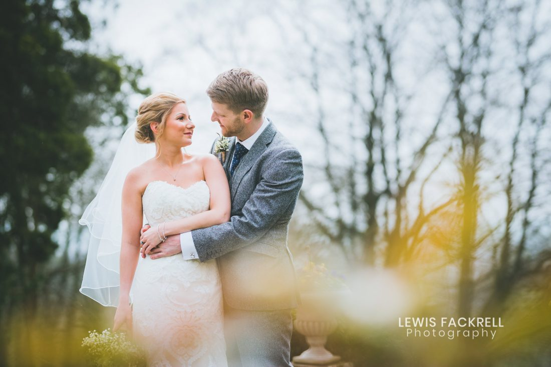 Coed y Mwstwr wedding photography Bride and groom holding eachother