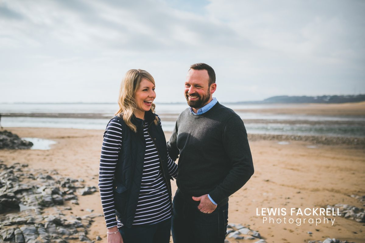Ogmore pre-wedding photo session of Lisa & Patrick laughing