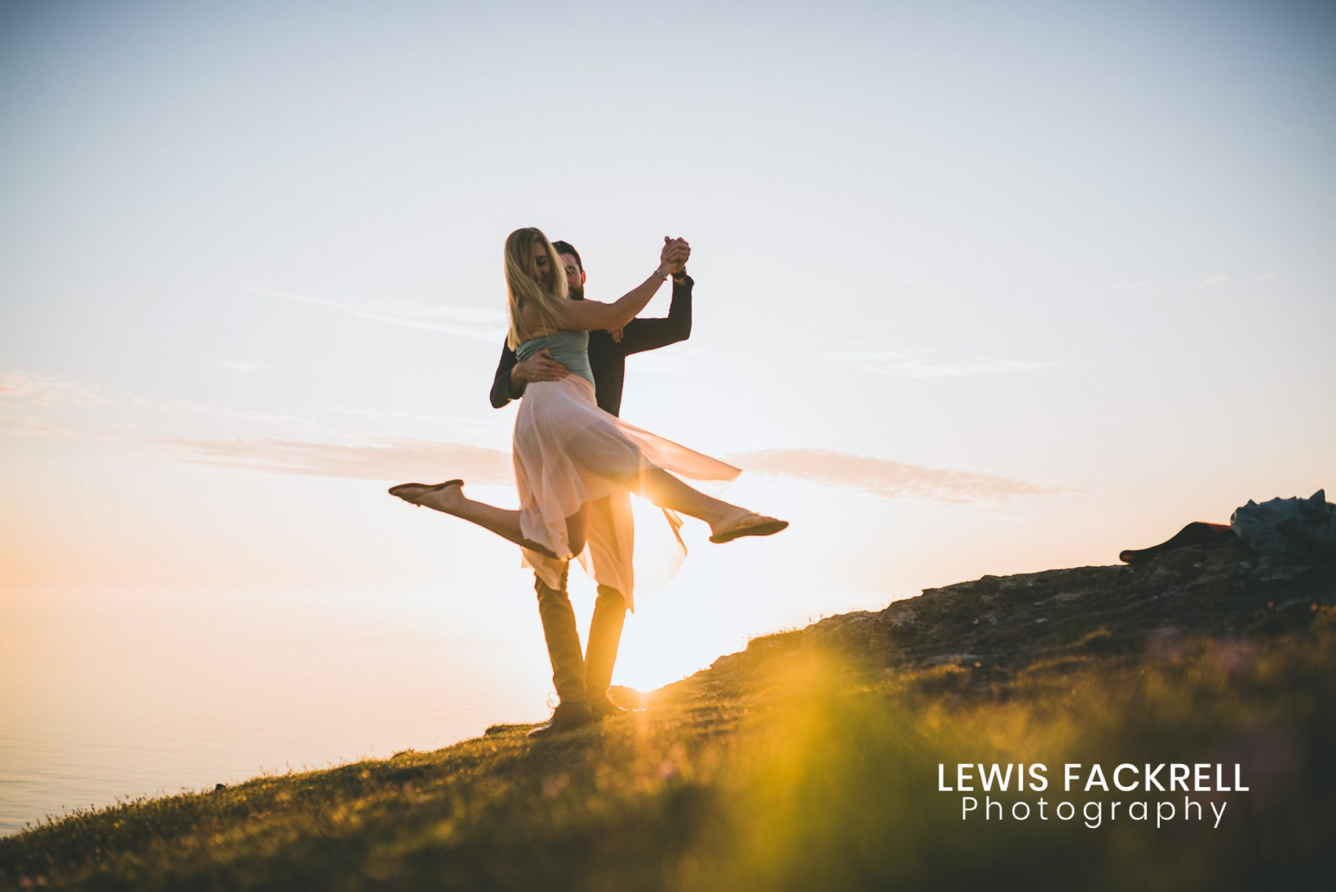 West Wales pre-wedding photography of couple dancing on the beach