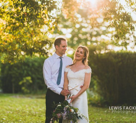 Fonmon castle wedding photography of the bride and groom under a tree at sunset