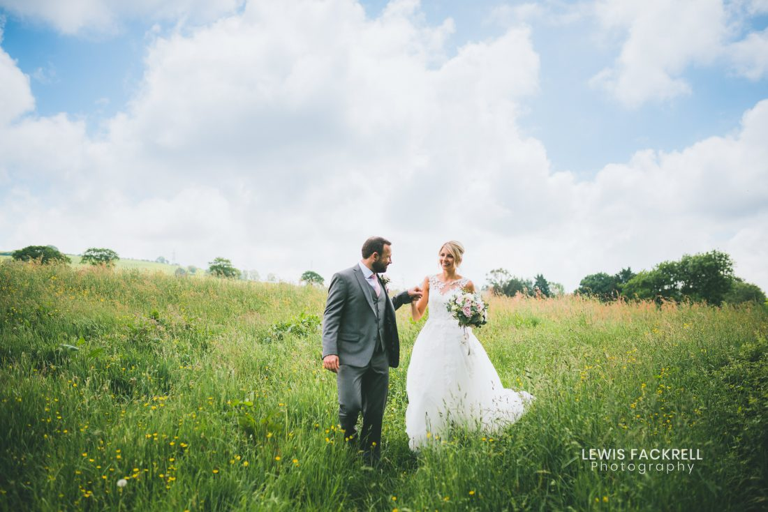 Pencoed House wedding photography of bride and groom in field