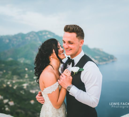 Couple stood on balcony at Ravello Destination wedding in Italy