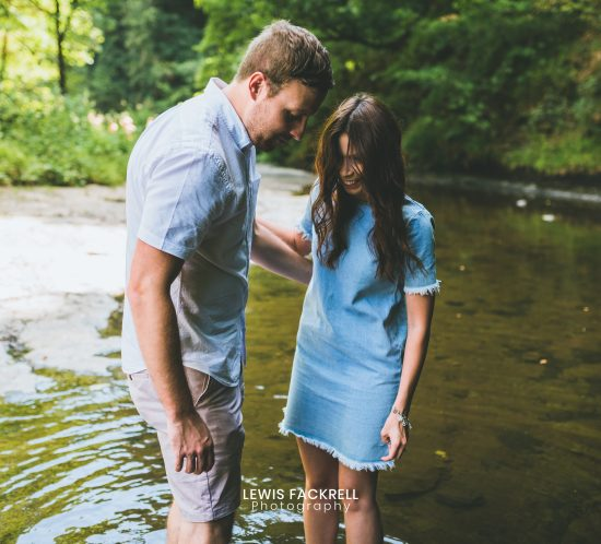Brecon pre-wedding photo session of couple in the river at brecon