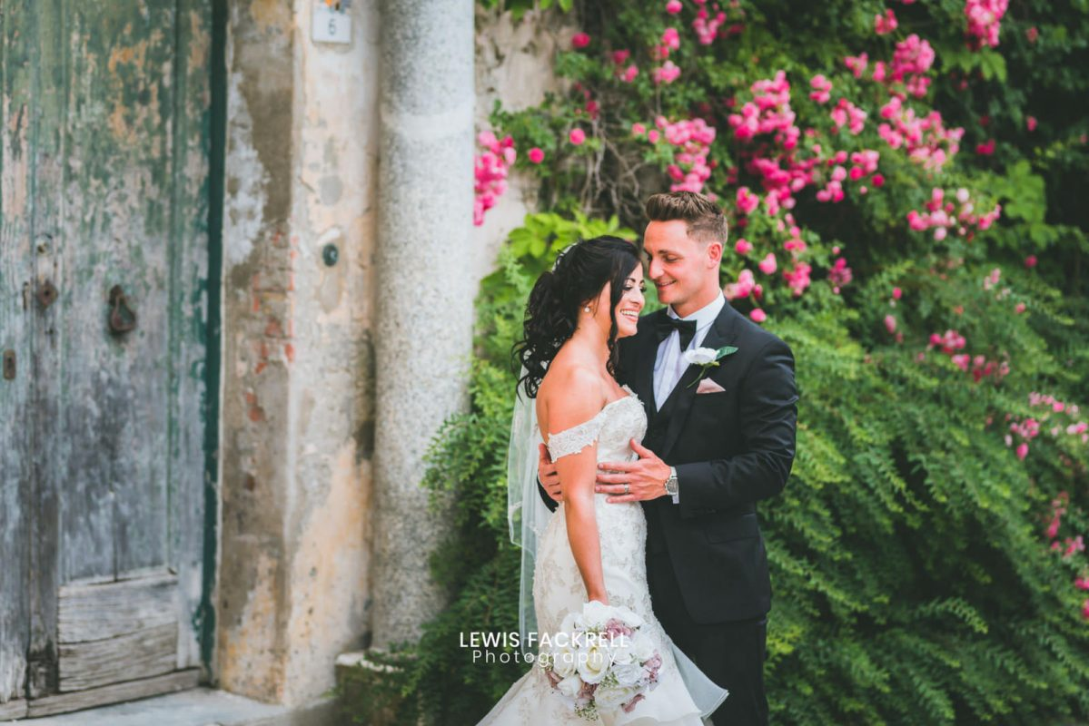 Ravello destination wedding photographer of couple in front of italian door holding eachother