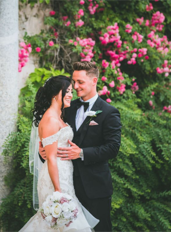 Ravello Destination wedding photography with the bride and groom laughing together in front of a doorway