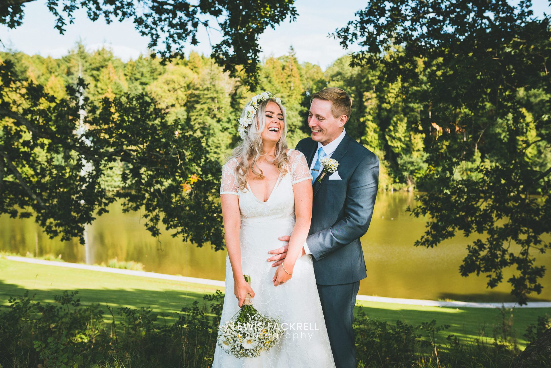 Cardiff wedding photography at Canada Lodge in summer of bride & groom laughing