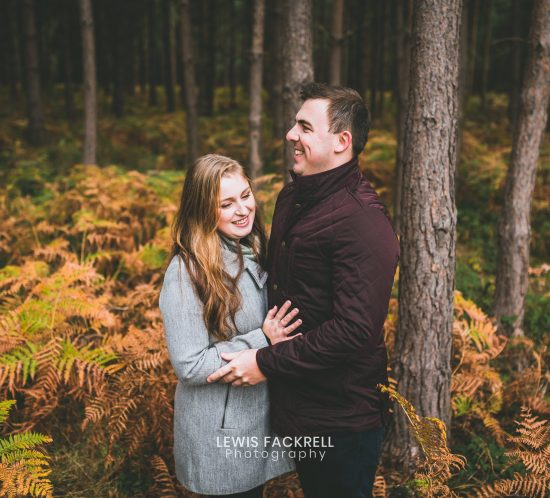Stafford pre wedding photography of couple in woods cuddling