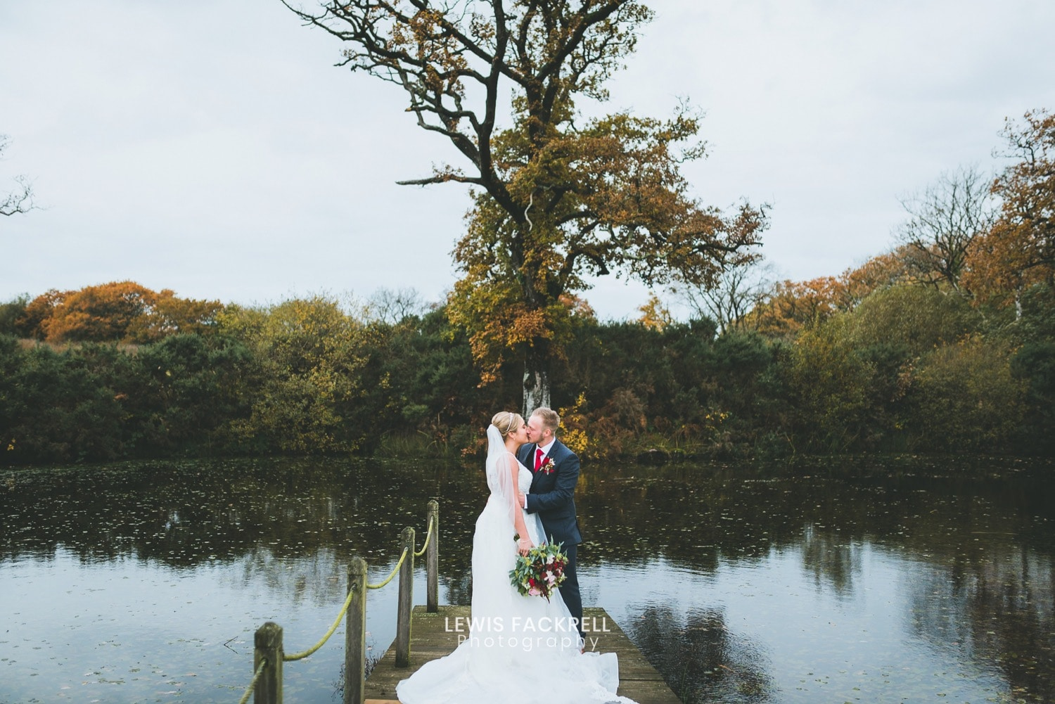 Oldwalls wedding photography of Bride and groom on the jetty at the venue in the Gower