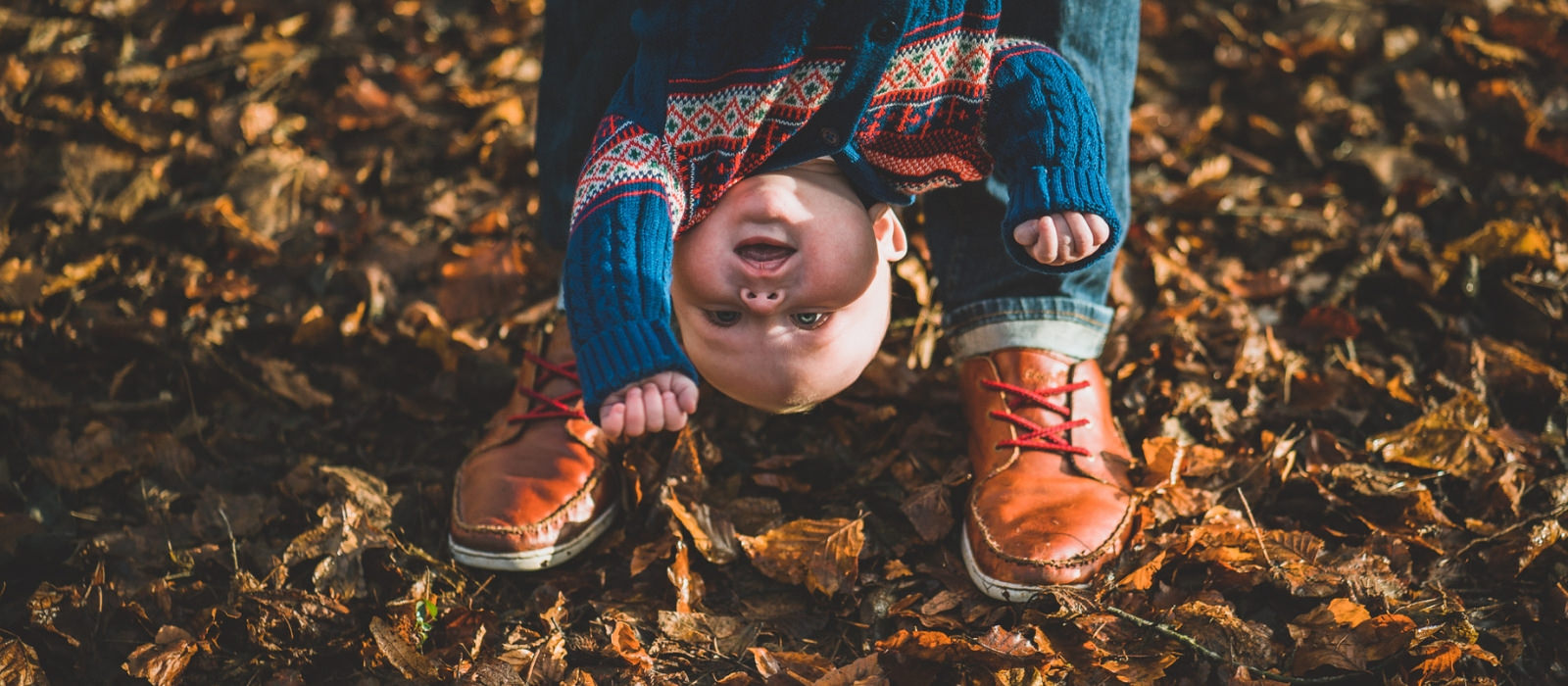 family photography session with baby upside down in Cardiff