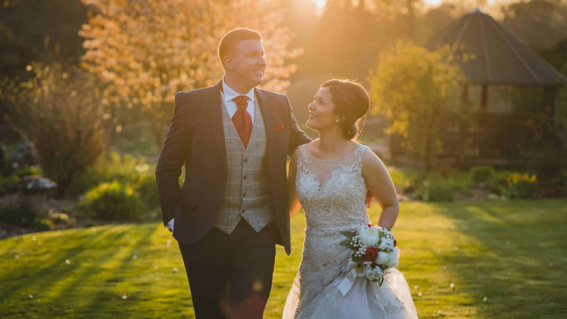 Miskin manor wedding photography of Bride and groom walking around the venue