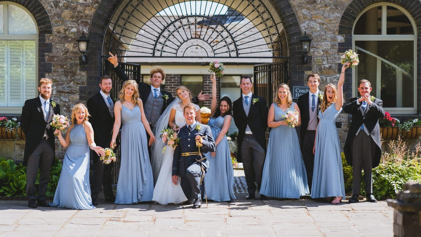 bridesmaids and groomsmen together at wedding