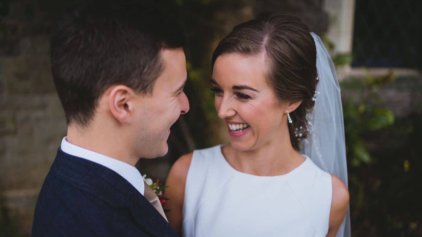 bride laughing after groom says something funny