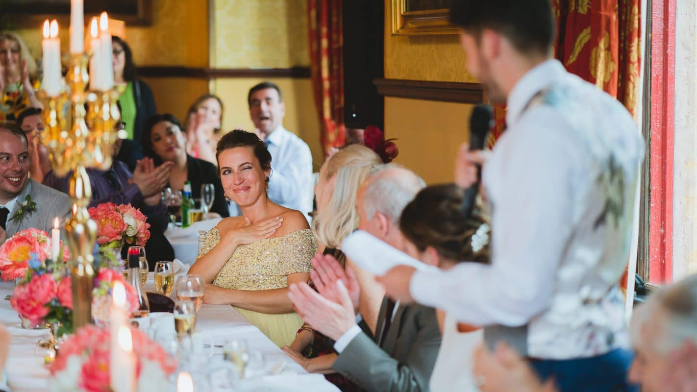 bridesmaid winking at groom during speeches
