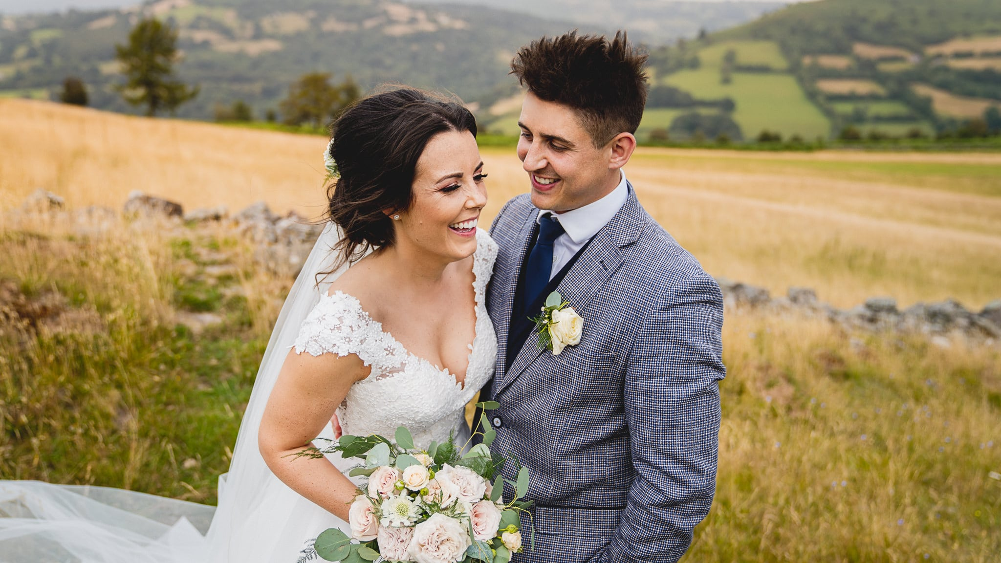 Sugar loaf barn wedding photography in South Wales of bride and groom laughing-1